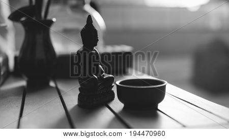 Thai Buddha Statuette During A Tea Ceremony Close-up. Buddhist Deities And The Culture Of Drinking T