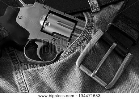 Revolver belt and jeans close up  photo
