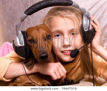 poster of The child and dog listen to music in headphones