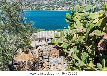 View To The Sea From The Top Of Spinalonga Fortress Later A Leper Colony. Plaka Village In The Backg