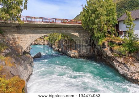 River and waterfall with bridge in Lom Norway. Nature and travel background
