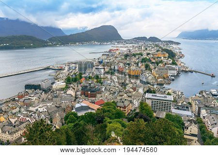 Alesund Norway - town houses on sea front travel background