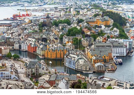 Alesund Norway - town houses on sea front, travel background