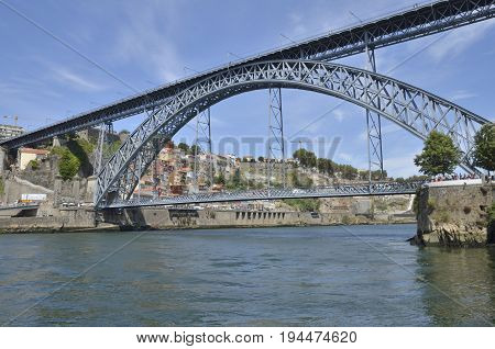 PORTO, PORTUGAL - AUGUST 7, 2015: The Dom Luis I Bridge that spans the River Douro between the cities of Porto and Gaia in Portugal.