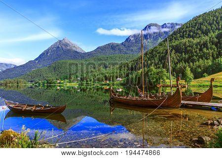 Old viking boats replica in a norwegian landscape Norway.