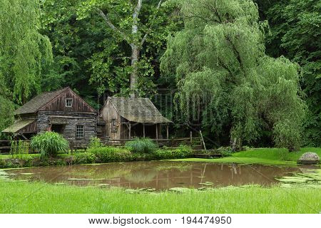 Wide Shot of Cuttalossa Farm Water Wheel, Sheep Barn, Clapboard Cottage, and Pond in Bucks County, Pennsylvania
