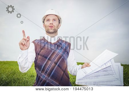 Architect engineer in white helmet and drawing thinks about good idea of project building house. Architect engineer solves technical task of building real estate object