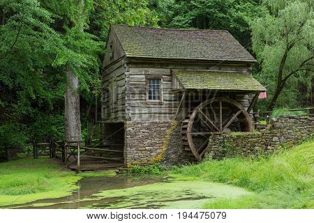 Cuttalossa Farm Water Wheel and Sheep Barn with Pond in Foreground in Bucks County, Pennsylvania