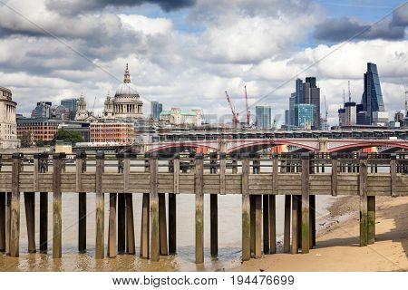 Wharf on the River Thames, with Blackfriars Bridge, St Paul's Cathedral and the City of London beyond.