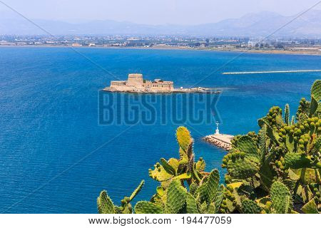 Bourtzi water fortress in Nafplio. Nafplio is a seaport town in the Peloponnese peninsula in Greece