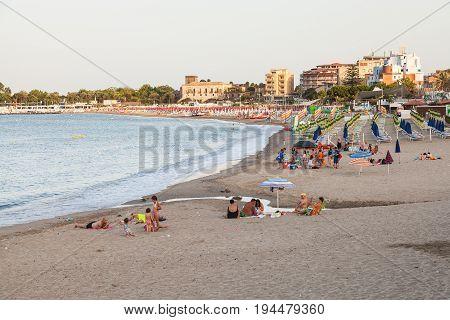 People On City Beach In Giardini Naxos Town