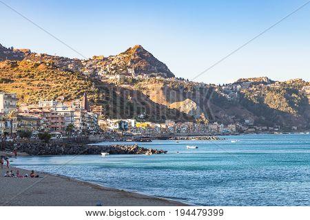 City Beach In Giardini-naxos And View Of Taormina