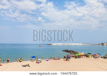 Beach In Giardini Naxos Town And View Of City Port