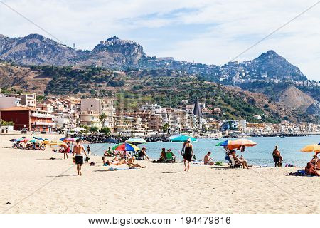 Vacationers On Sand Beach In Giardini Naxos Town