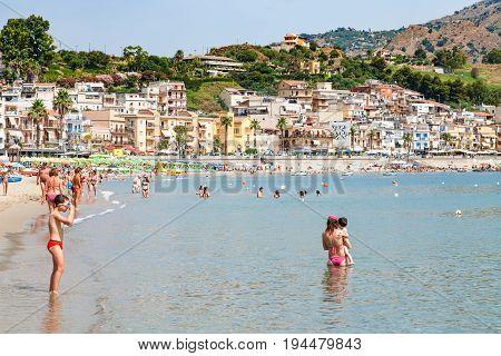 People On Beach Near Waterfront Of Giardini Naxos