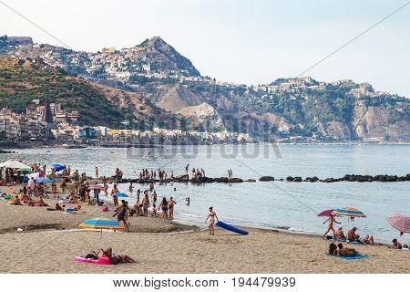 Urban Beach In Giardini-naxos Town In Evening