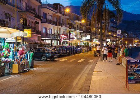 People Near Gift Shops In Giardini Naxos In Night