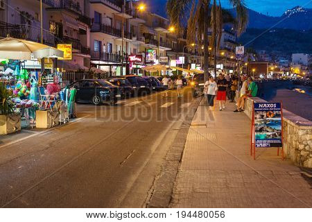 Tourists Near Shops In Giardini Naxos In Night