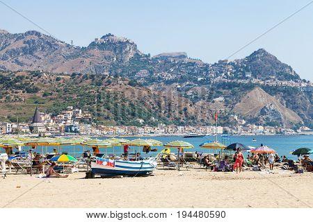 Beach In Giardini Naxos And View Of Taormina City