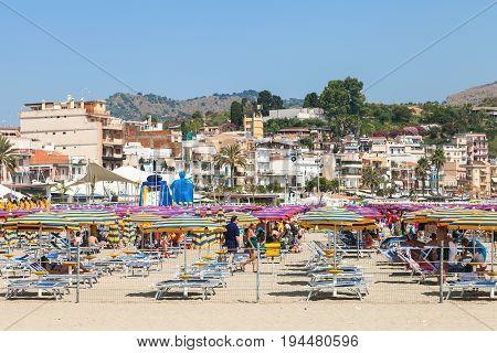 People On Urban Beach In Giardini Naxos City