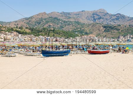 Vacationers And Boats On Beach In Giardini Naxos