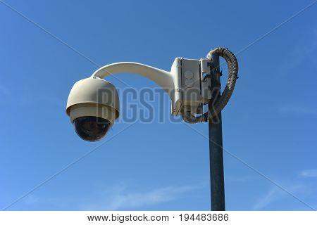 Urban video surveillance camera on the street lamp