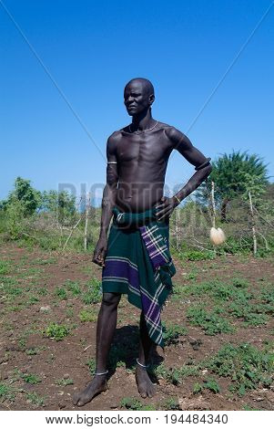 Mago Omo valley Ethiopia- 03 october 2012: Mursi tribe man in national dress