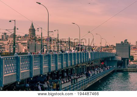 Istanbul, Turkey - June 22, 2017: View front of the Galata Bridge and Galata Tower over Halic.