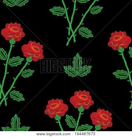Embroidery stitches imitation seamless pattern with red roses. Fashion embroidery rose flower on black background. Embroidery seamless with roses vector.