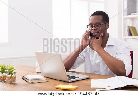 African-american businessman in office making business call, copy space