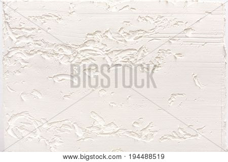 White wall with plaster pattern background. Textured backdrop, design repair, bas-relief. House repair, interior design concept