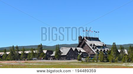 YELLOWSTONE NATIONAL PARK, WYOMING - JUNE 26, 2017: Old Faithful Inn seen from the Upper Geyser Basin Trail in Yellowstone National Park, Wyoming.