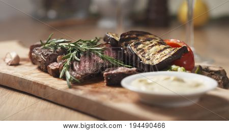 rib eye steak with grilled vegetables, wide photo