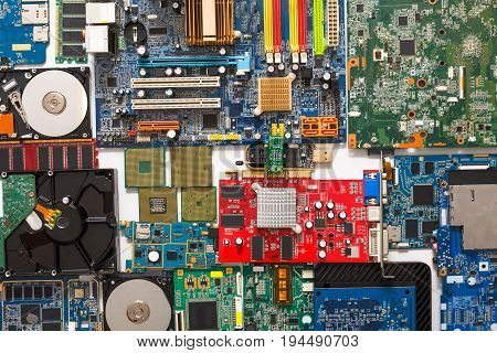 Computer microcircuits, processor chips and hard drives disassembled closeup. Electronic parts of computer background, top view