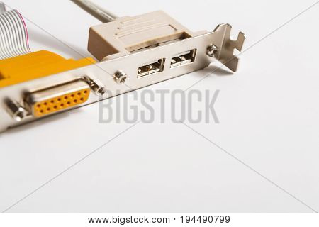 VGA and dual USB outs of computer motherboard on white background. Closeup, copy space