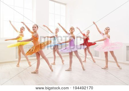Group of young ballet dance students performing. Girls dancing ballet, choreography practicing, copy space