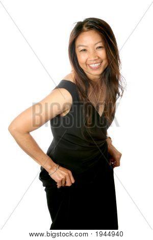 Happy Mature Thai Female In Black Dress