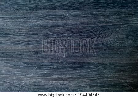 Dark wood texture background surface with old natural pattern or old wood texture table top view. Grunge surface with wood texture background. Vintage timber texture background. Rustic table top view.