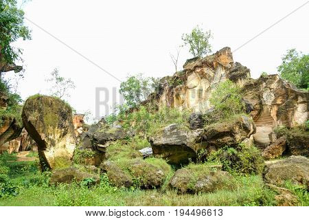 The exploitation of limestone hills canyon forming a unique architectural in Arosbaya Hill Madura Island, Indonesia