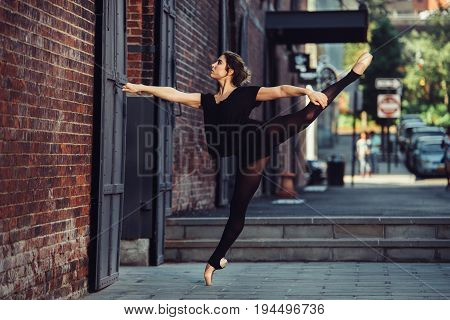 Elegant ballet dancer woman dancing ballet in the city