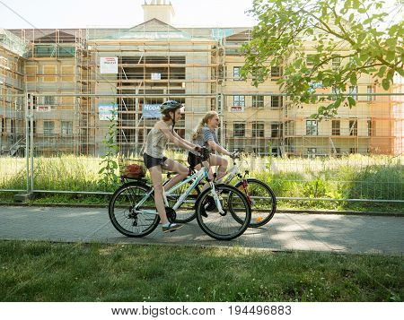 KEHL; GEMRANY - MAY 29; 2017: Young German girls riding a bycicle in german city of Kehl near the German French border
