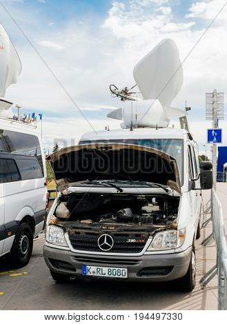 STRASBOURG FRANCE - JUN 30 2017: Mercedes TV Media Television Trucks with multiple Satellite parabolic antennas and fiber optic cables preparing to report live the official European Ceremony of Honour for Dr. Helmut Kohl at European Parliament