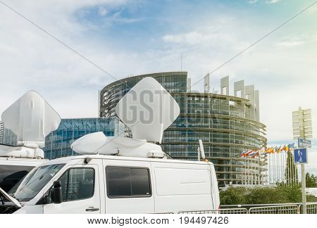 TV Media Television Trucks with multiple Satellite parabolic antennas and fiber optic cables preparing to report live the official European Ceremony debate government decision