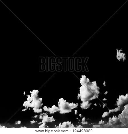 Isolated white clouds on black sky. Set of isolated clouds over black background. Design elements. White isolated clouds. Cutout extracted clouds.