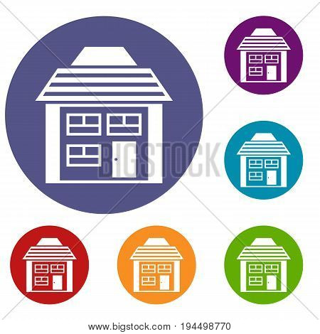 Two-storey house with sloping roof icons set in flat circle reb, blue and green color for web