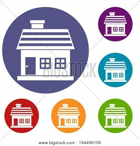 One-storey house icons set in flat circle reb, blue and green color for web