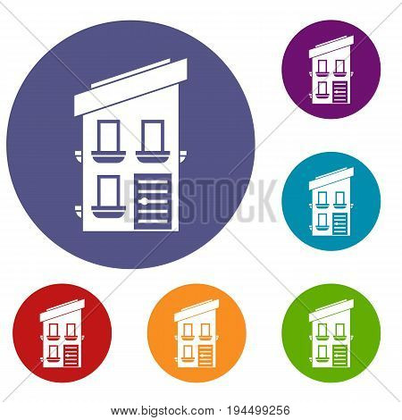 Two-storey house icons set in flat circle reb, blue and green color for web
