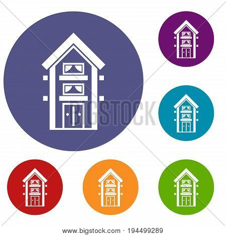 Two-storey house with balconies icons set in flat circle reb, blue and green color for web