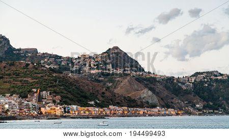 Giardini Naxos Town Below And Taormina City Above
