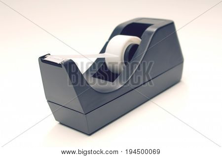 Adhesive tape with dispenser